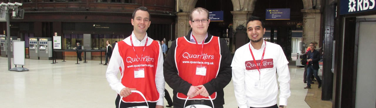Three Morgan Stanley staff members fundrasiing in Central Station Glasgow